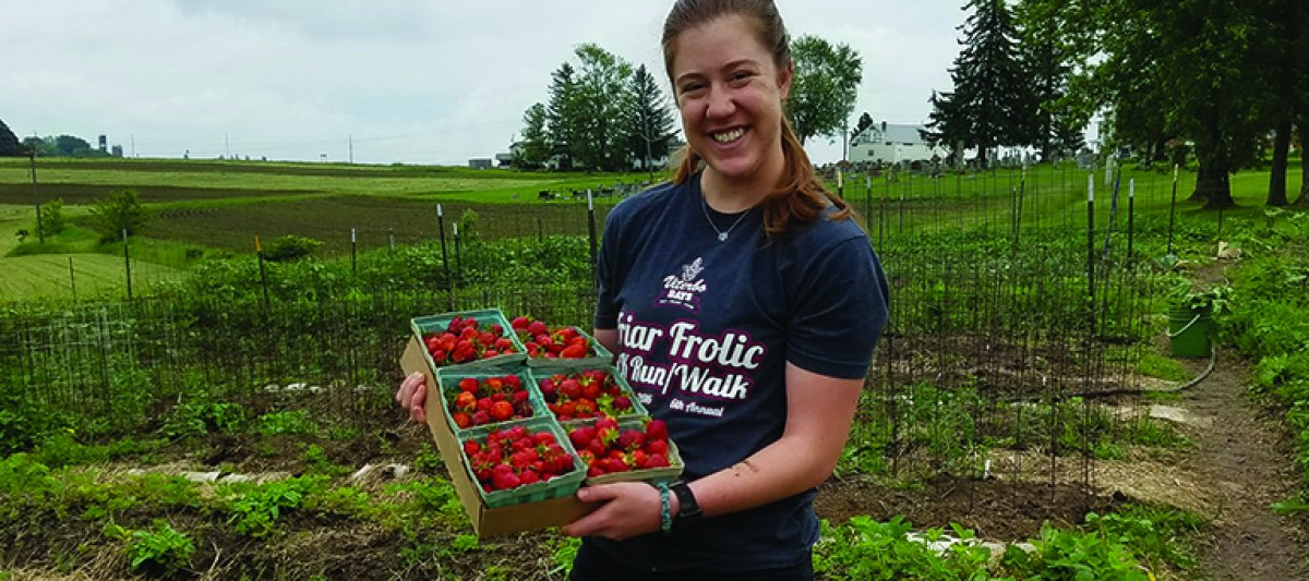 Hannah with strawberry harvest