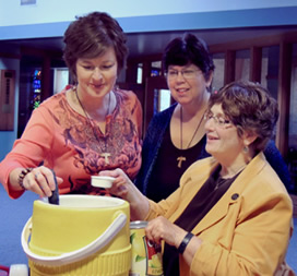 Gayla Rummans, Laurie Brown and Margie Bleuer prepare refreshments
