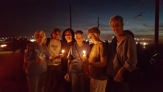 8th Day Center for Justice staff at vigil for migrants at Eloy Detention Center