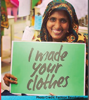 Woman holding a sign that reads I made your clothes
