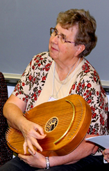 Sister Carrie Kirsch plays the Reverie Harp during a breakout session