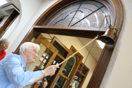 A Franciscan Sister of Perpetual Adoration joins the bell ringing to commemorate 140 years of prayer