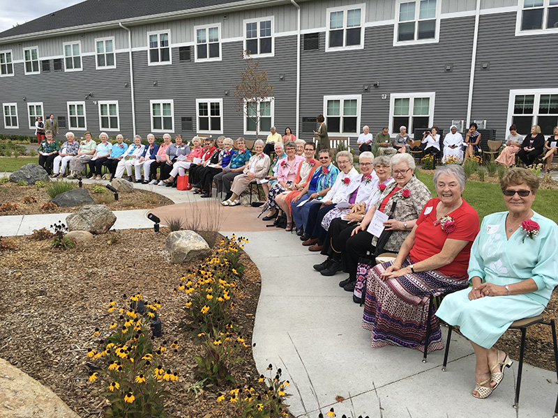A group of Franciscan Sisters celebrate the dedication of Garden View Grotto