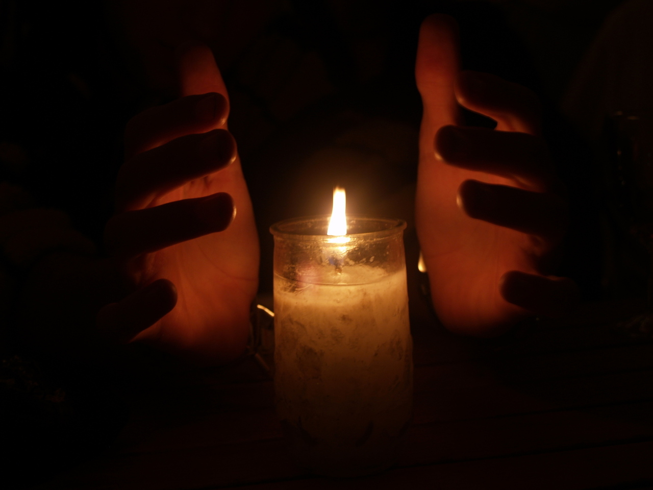 hands-lit-candle-courtesy-freeimages.com