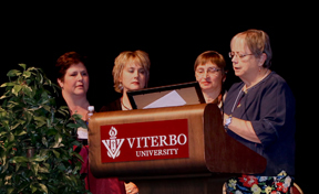 St. Anthony Nursing Home reps receive the Christian Mission Award for the Bucket List Program from Sister Jean Moore