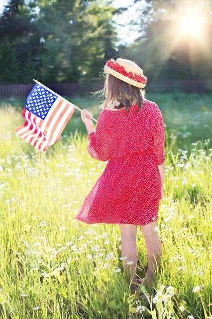 woman-outside-red-dress-hat-american-flag