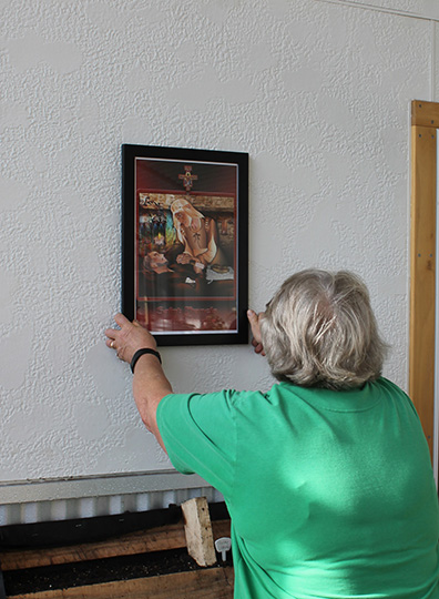 Sister Lucy placing Blessed Jacoba picture in greenhouse