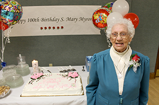 Sister Mary Myron with cake