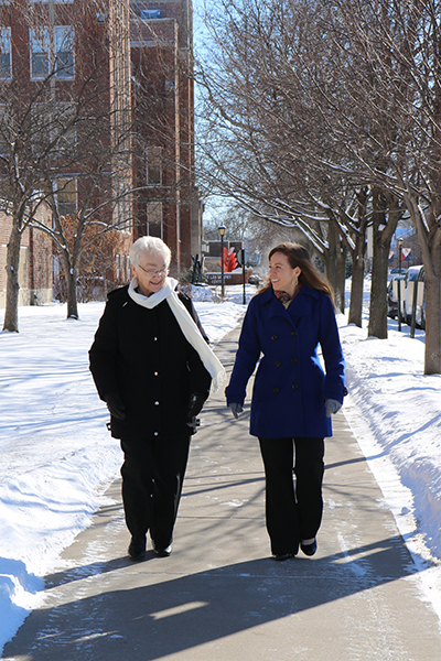 Sister Jean Kasparbauer and affiliate Ashley Skoczynski take a winter walk around St. Rose