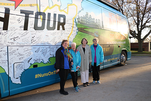 Pat Ruda and Sisters Betty Daugherty, Nancy Hoffman and Joann Gehling pictured with the Nuns on a Bus tour bus