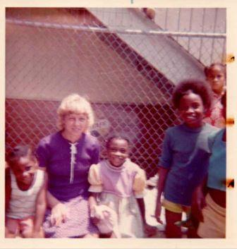polaroid-photo-woman-children-chain-link-fence