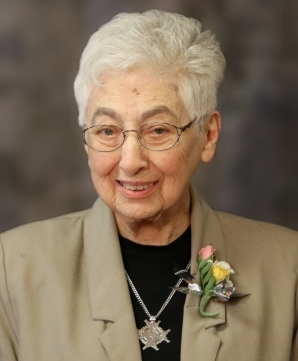 woman-white-hair-glasses-corsage