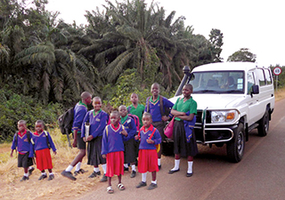 Children standing by new vehicle