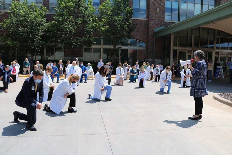 Sister Eileen McKenzie offers prayer at Mayo during white coats for black lives