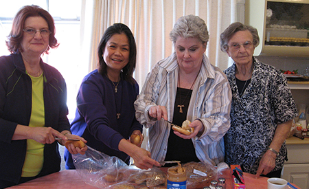 Las Vegas affiliates and Sister Lorraine Forster making sandwiches for homeless