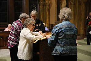 sisters signing scroll in adoration ritual