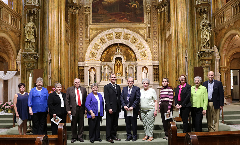 Commissioned members pose in Mary of the Angels Chapel