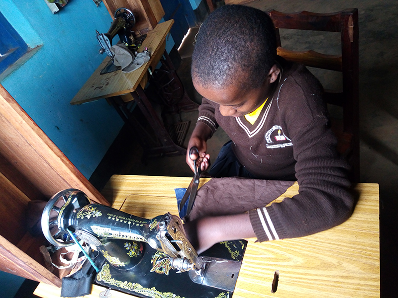 Tekla Kagera student learns to sew